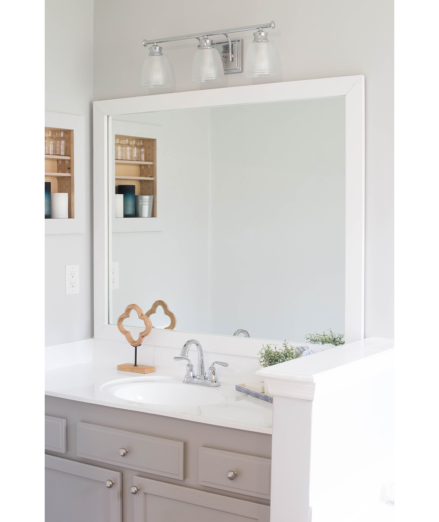 Bathroom mirror with white frame