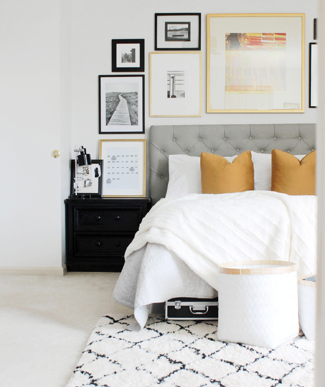 Bedroom with tufted headboard