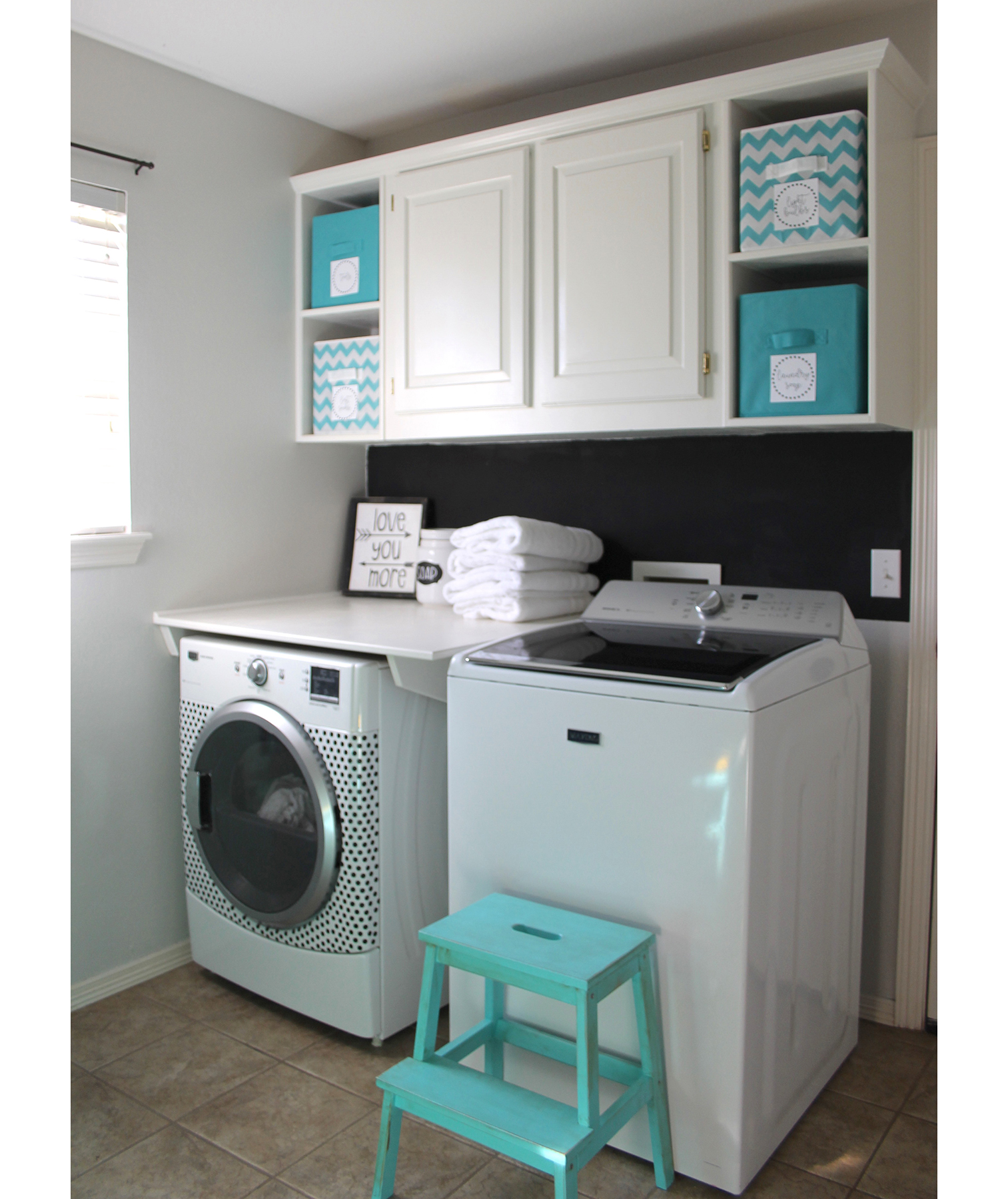 "Laundry room with ""custom"" cabinets"
