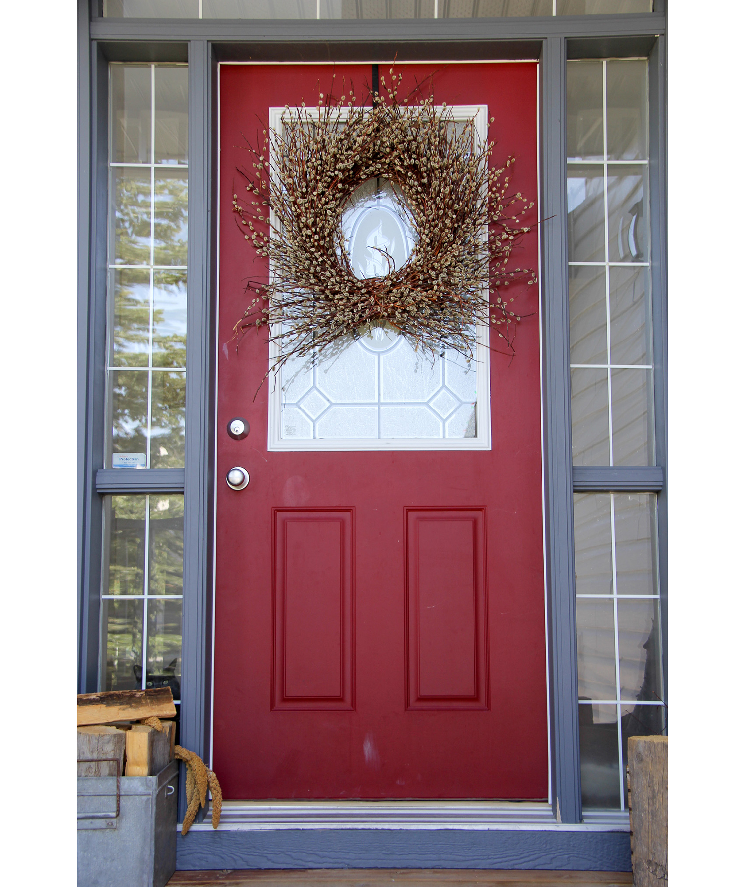 Dark red front door with wreath