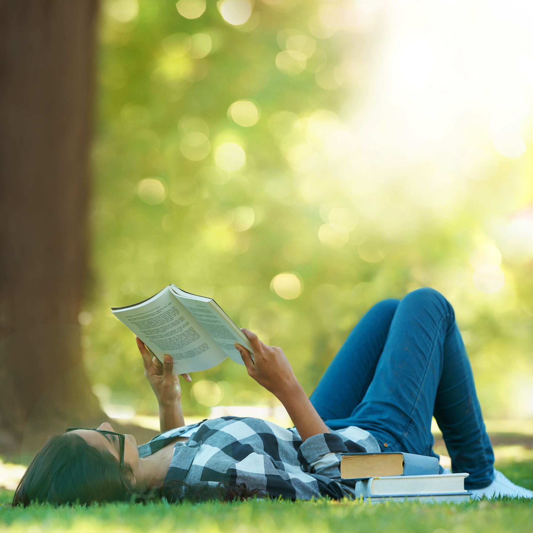 Woman lying in the grass and reading