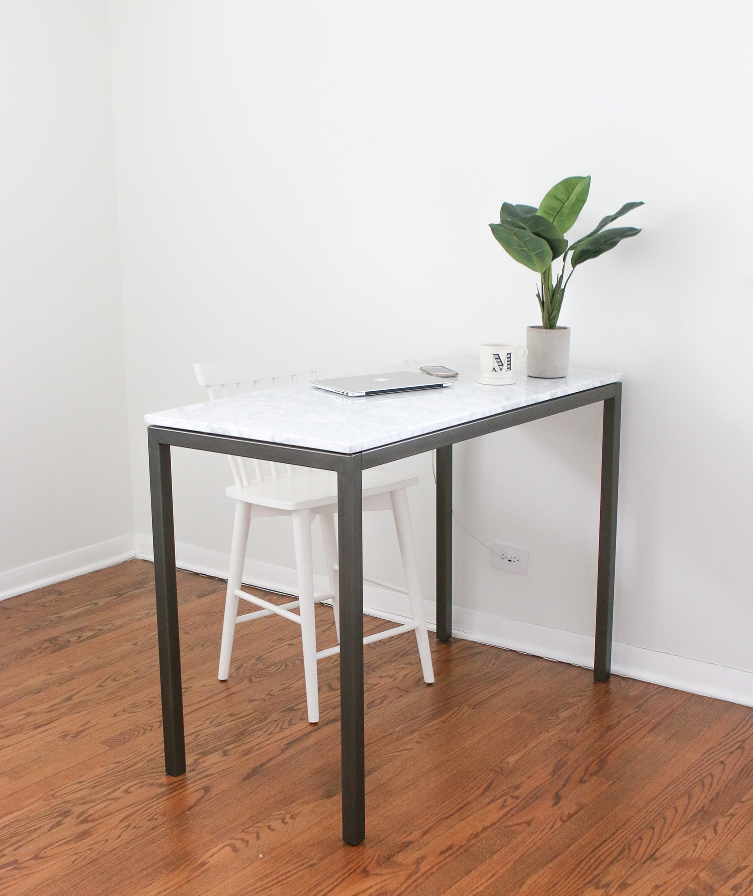 Plain white room with desk