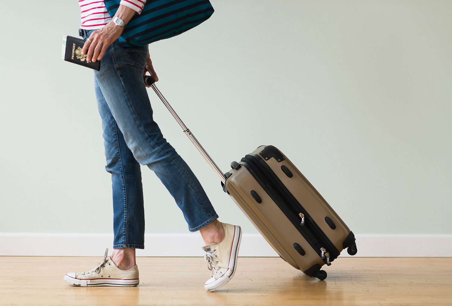 Woman Carrying Luggage Through Airport