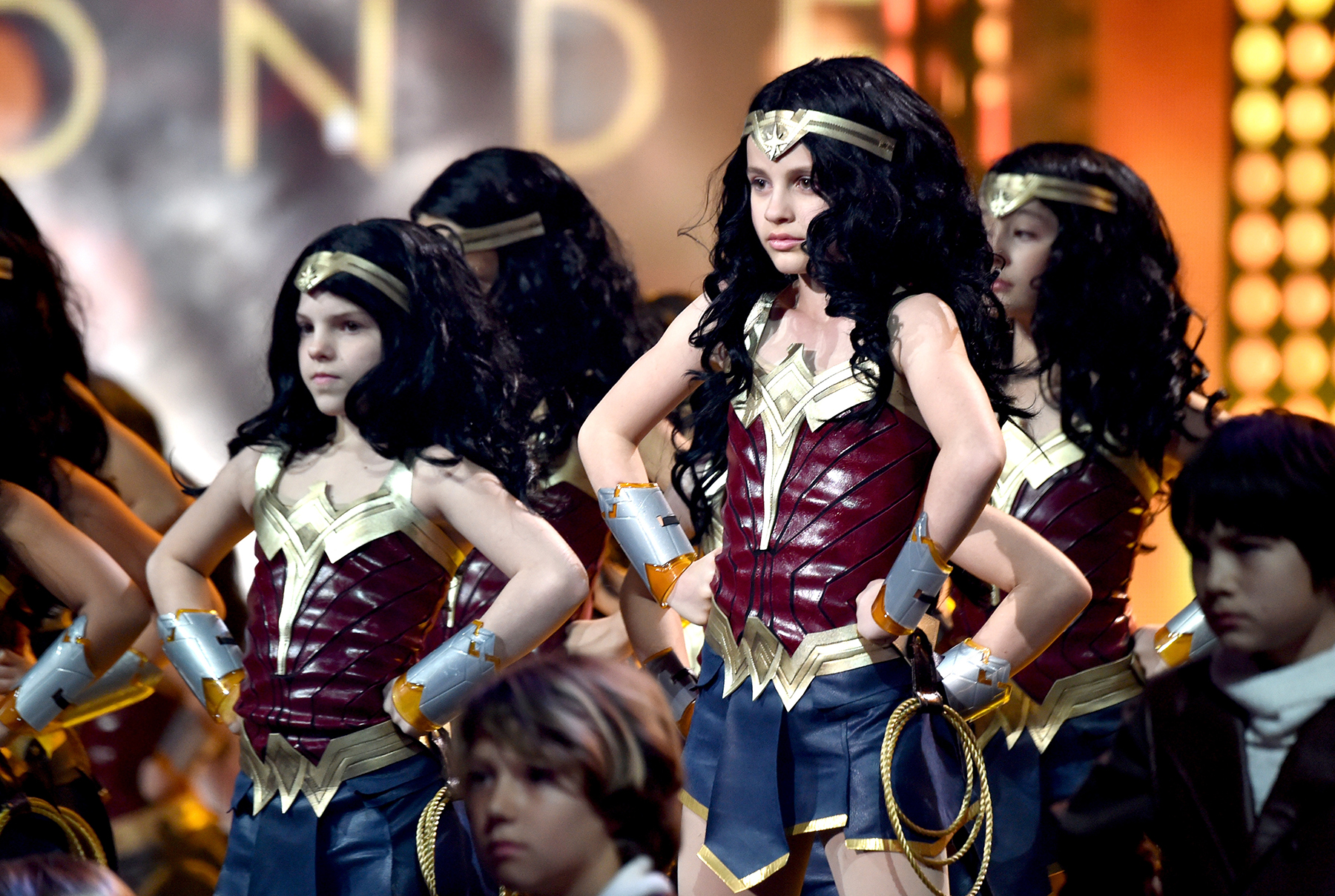 Girls on stage at 2017 Nickolodeon Kids' Choice Awards dressed as Wonder Woman