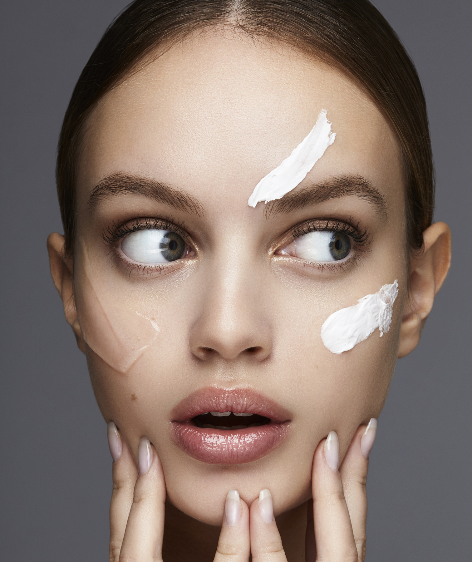 Model with multiple skin products on face