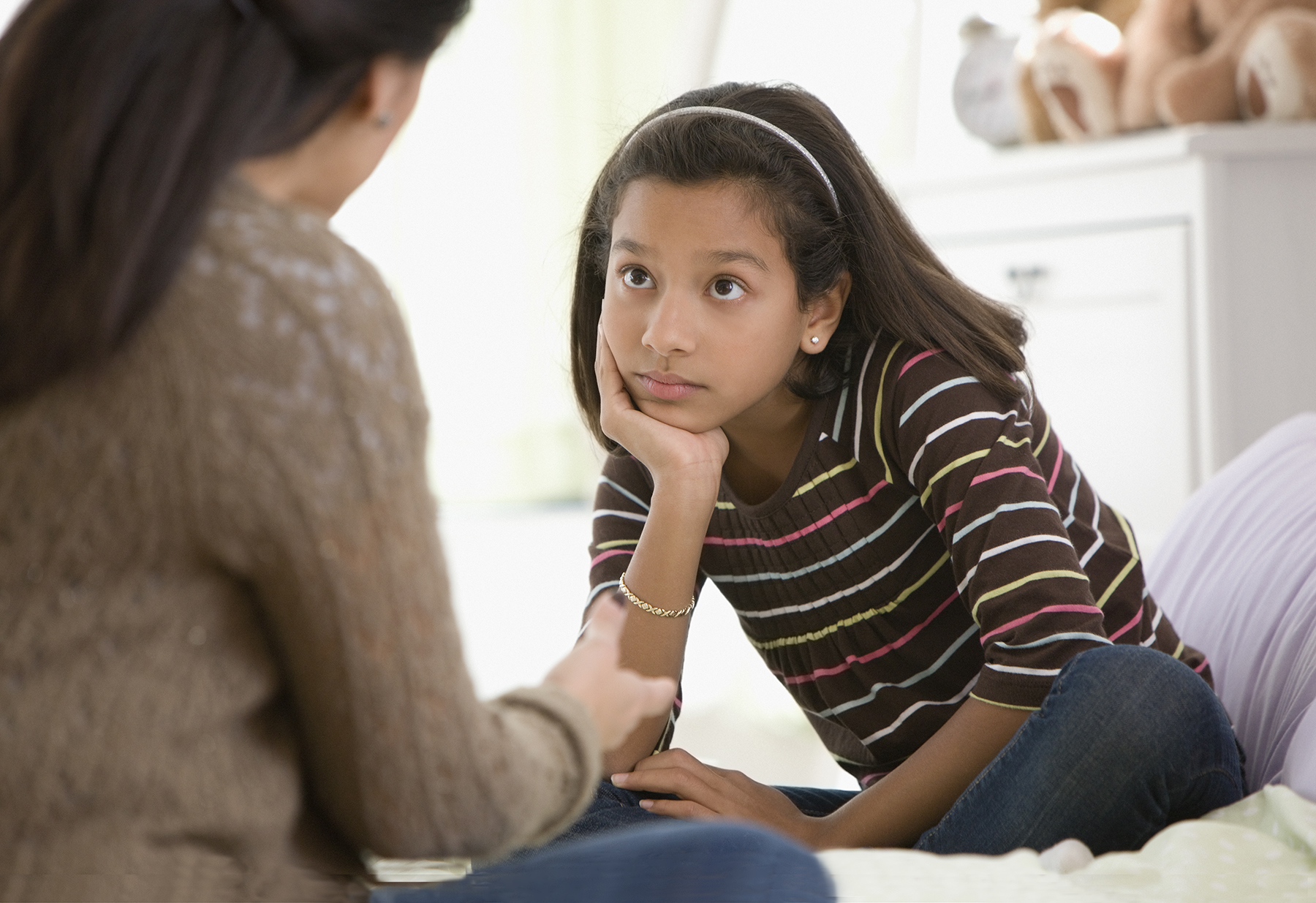 Mother having talk with daughter