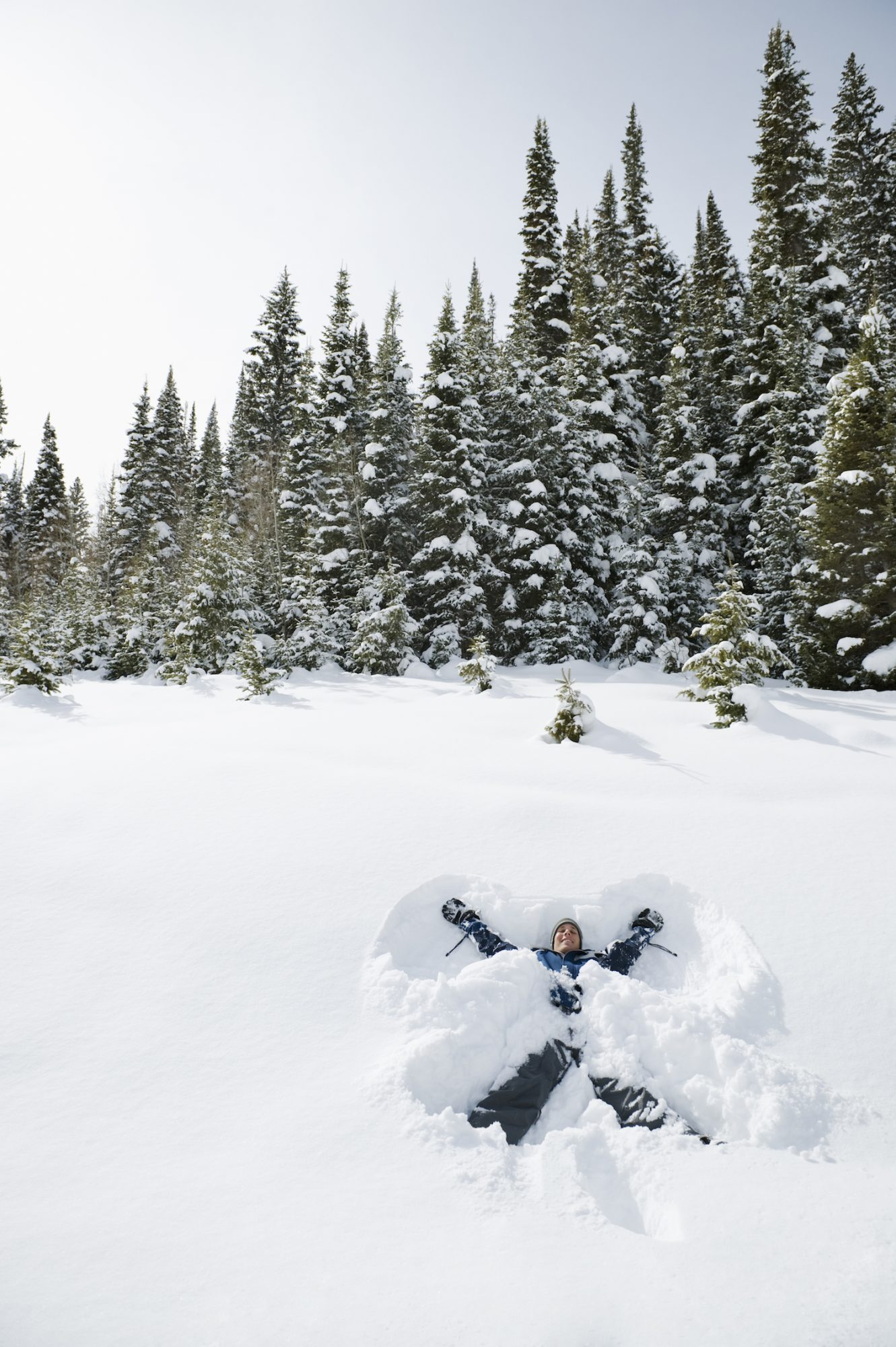 woman making snow angels