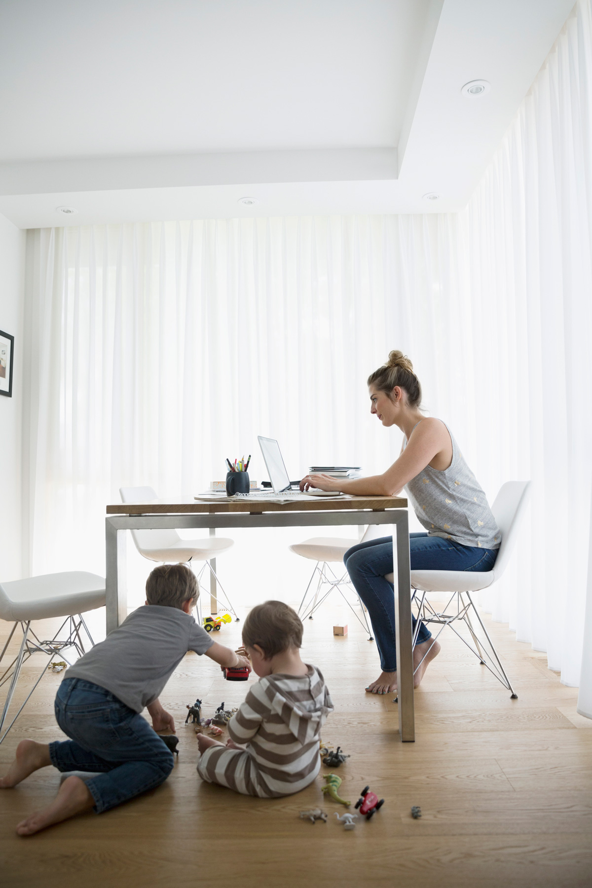 Woman working with kids under table
