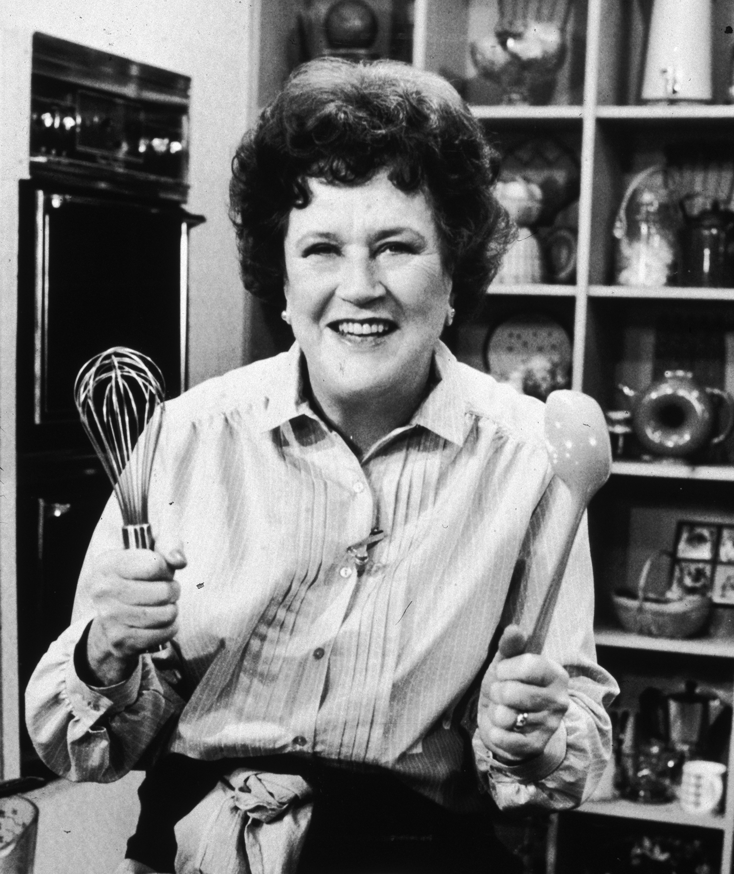 Julia Child with whisks