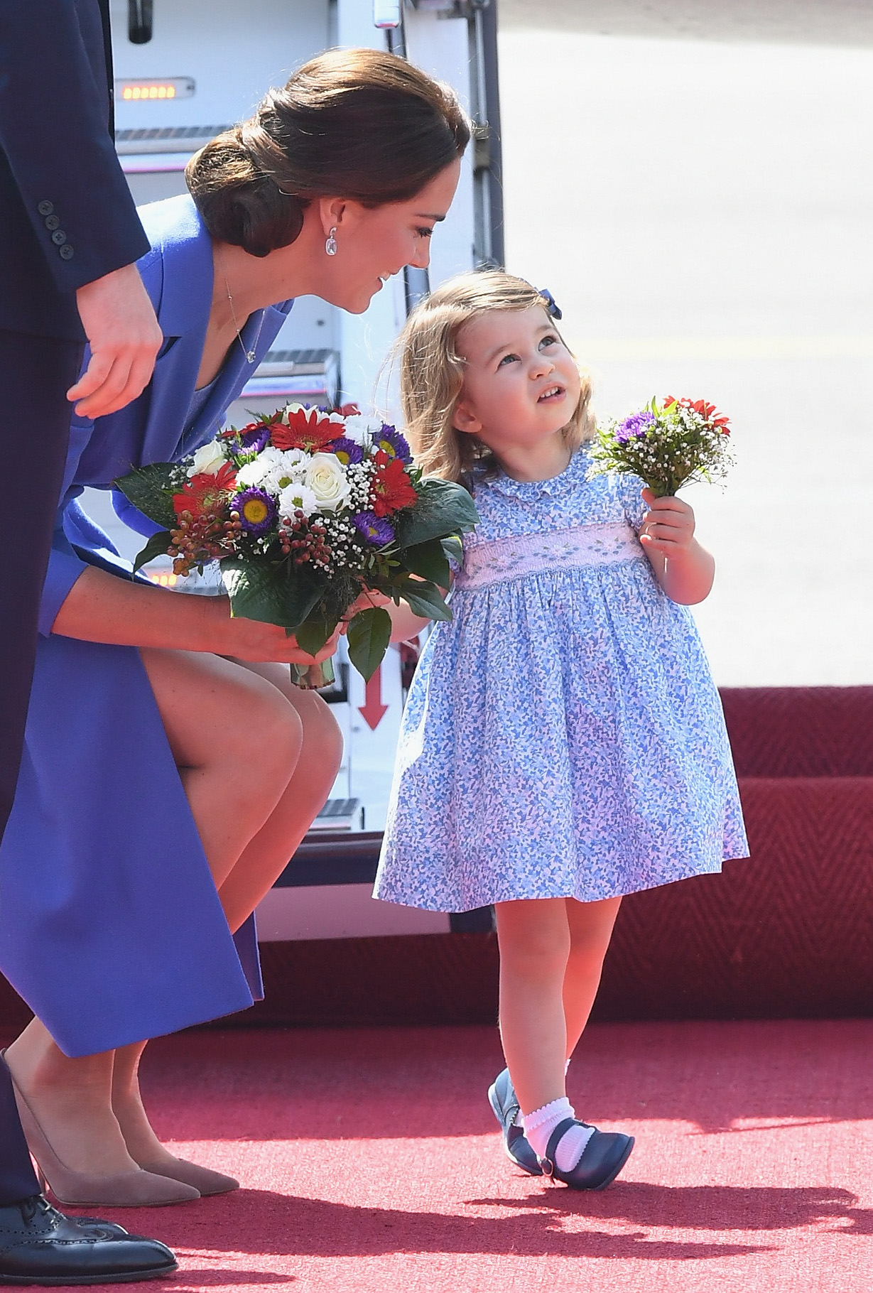 princess kate with charlotte and flowers