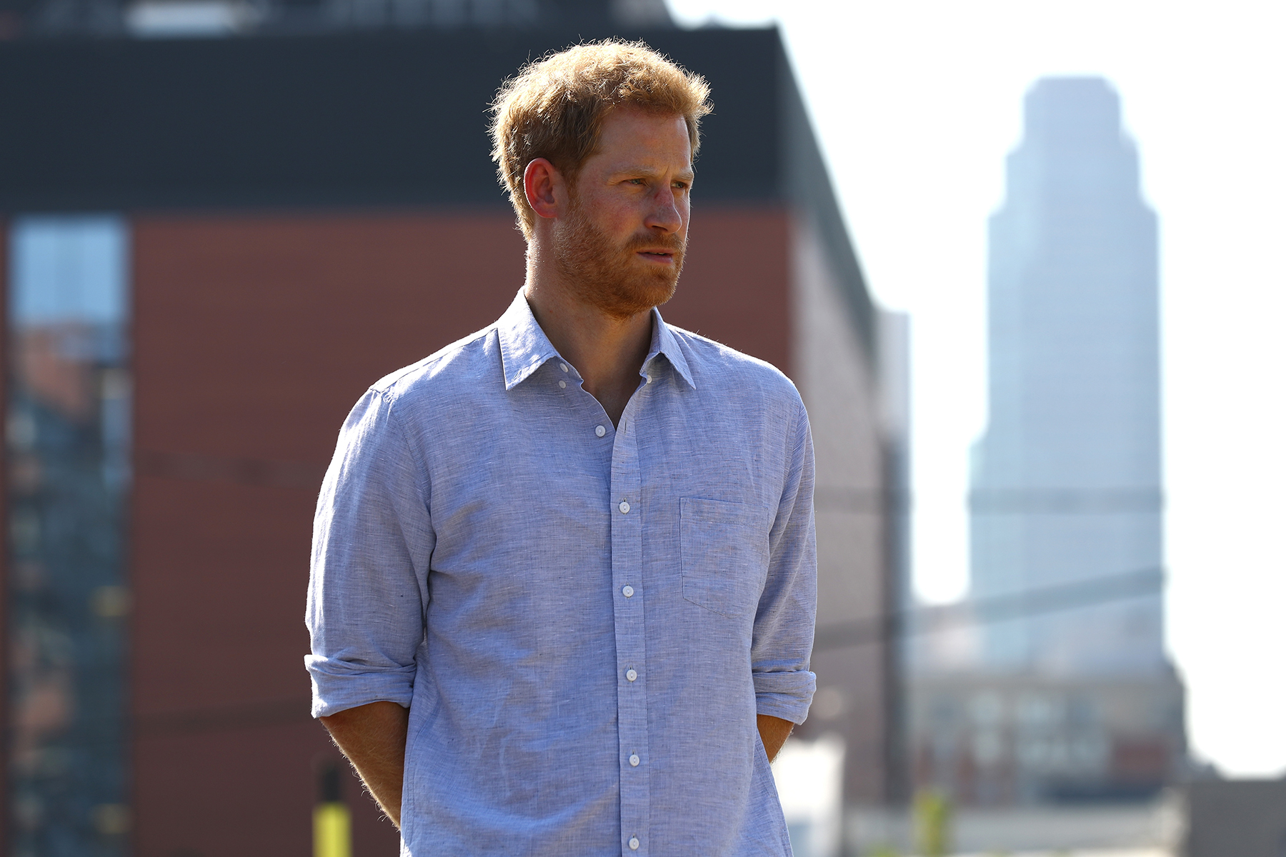 Prince Harry in blue shirt