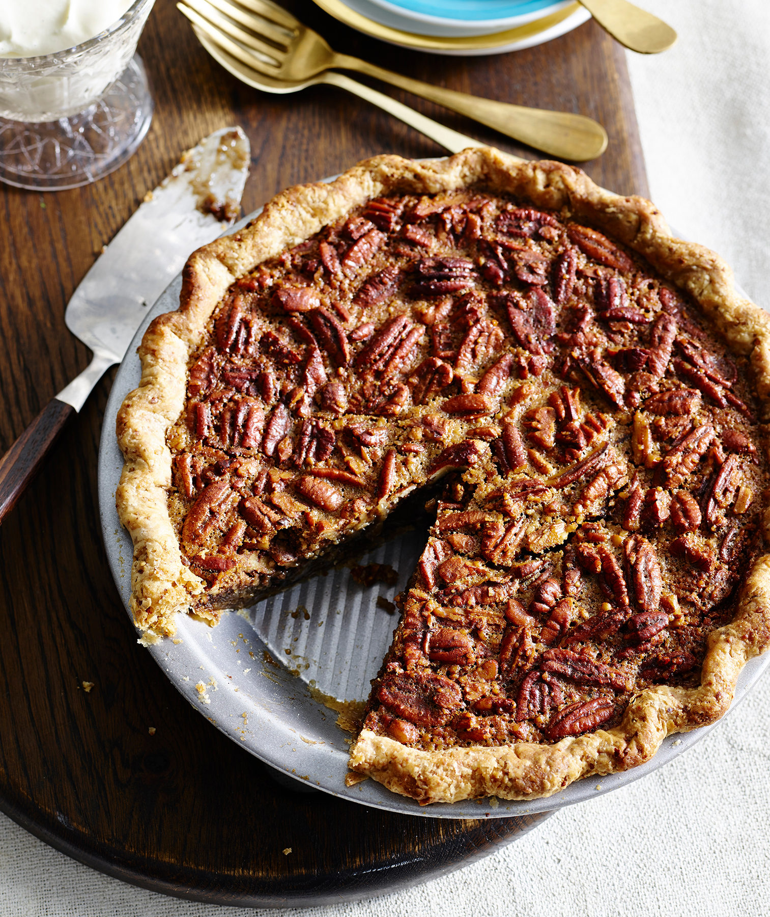 Pecan pie with whipped cream, plates