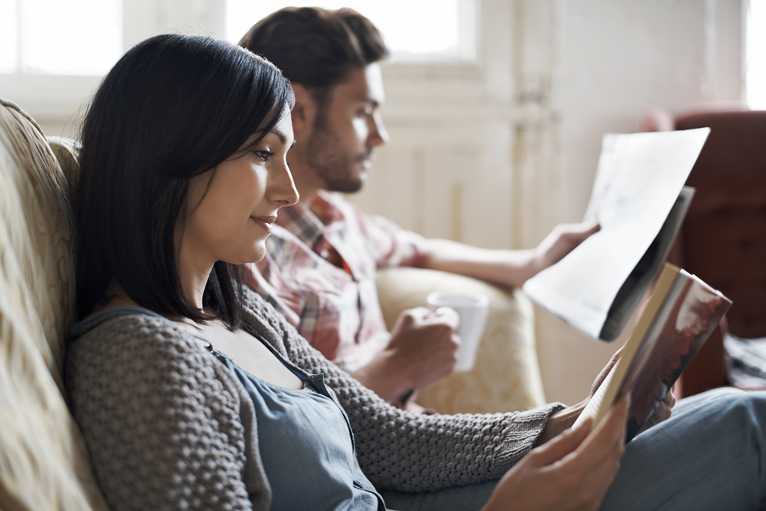 Couple Reading Peacfully on Couch