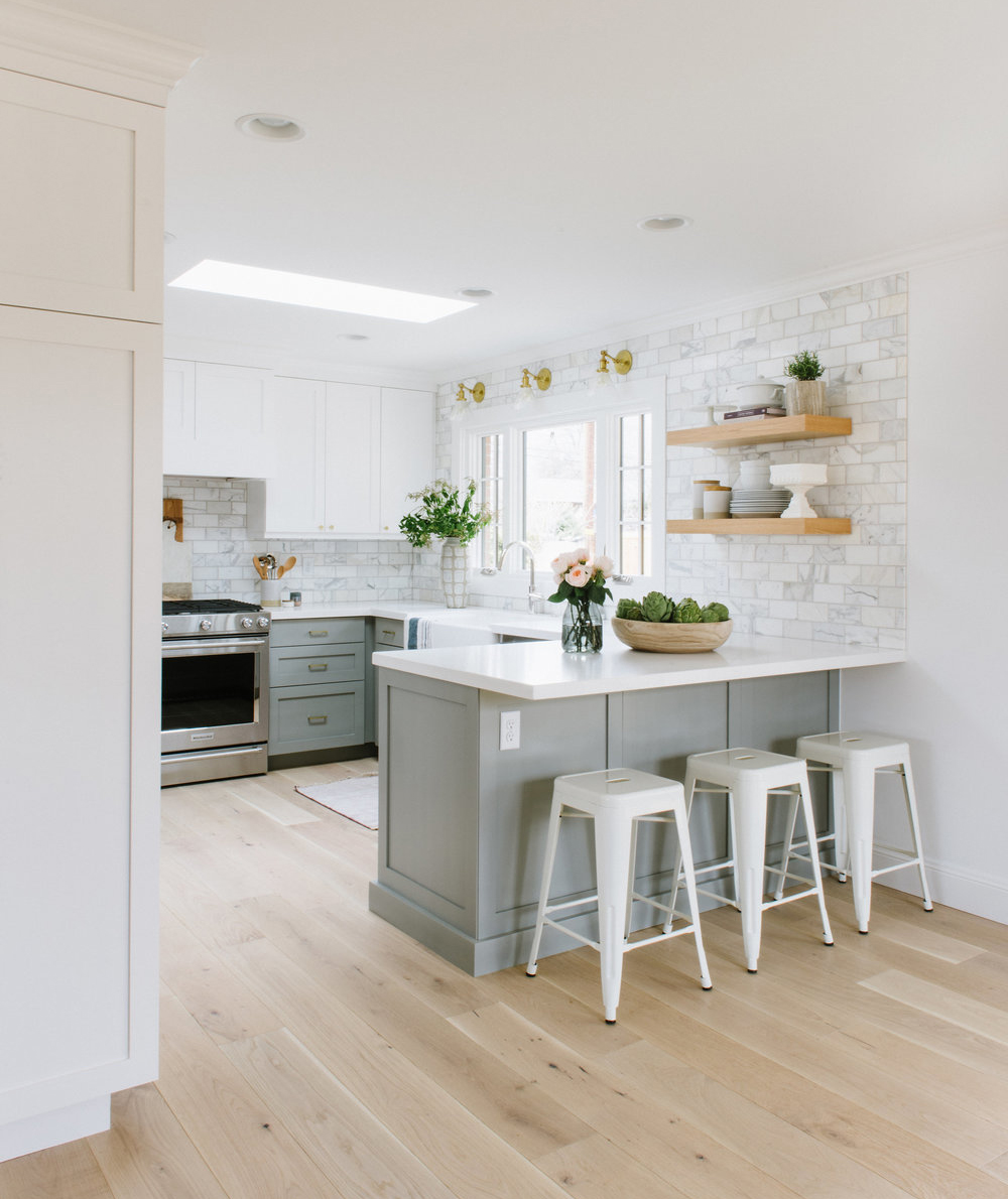 Airy kitchen with counter and barstools