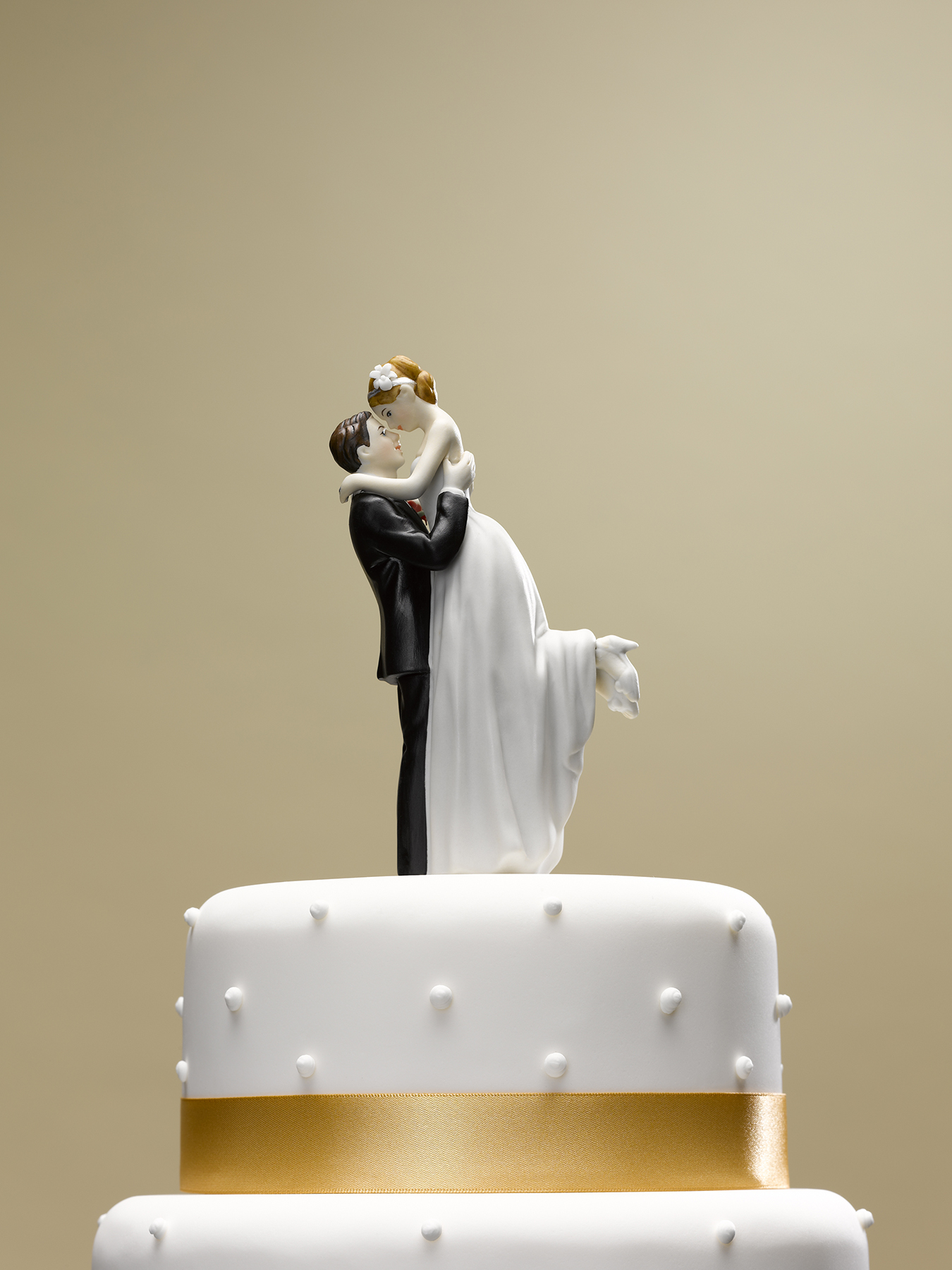 Bride and groom topper on wedding cake