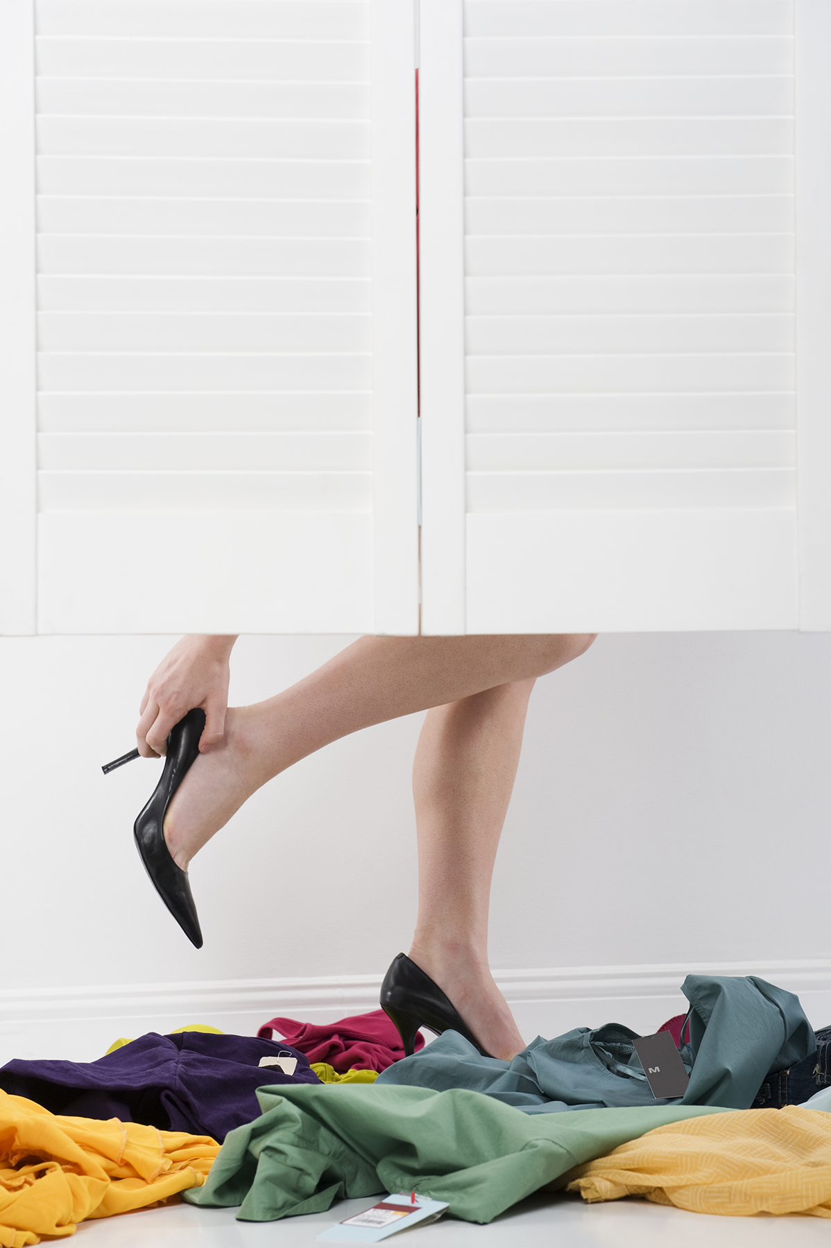Woman in high heels in fitting room