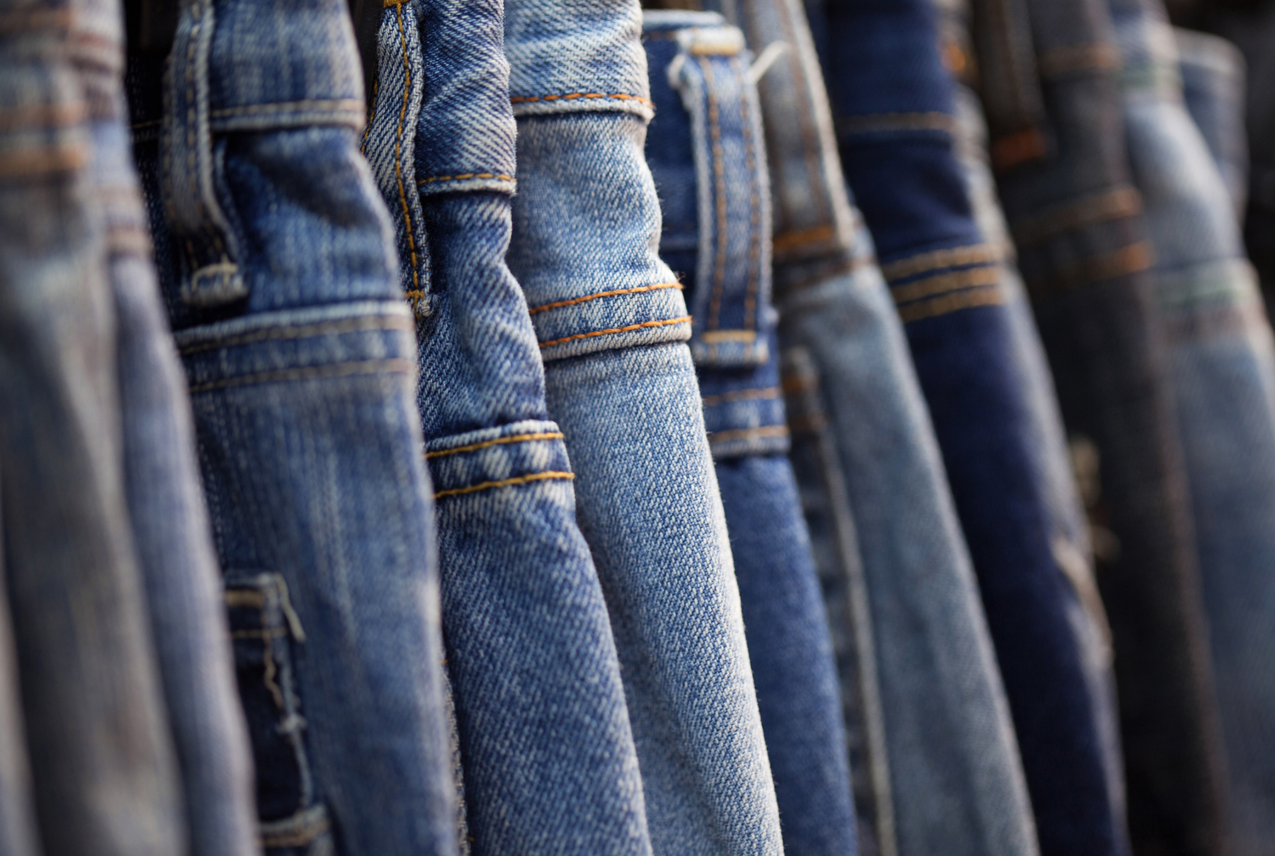 Hanging pairs of jeans