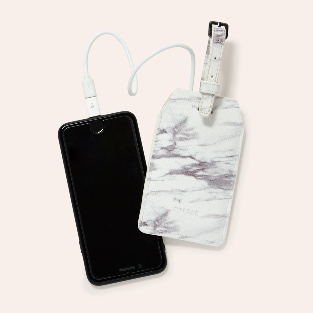 calpak travel marble luggage tag with charging port