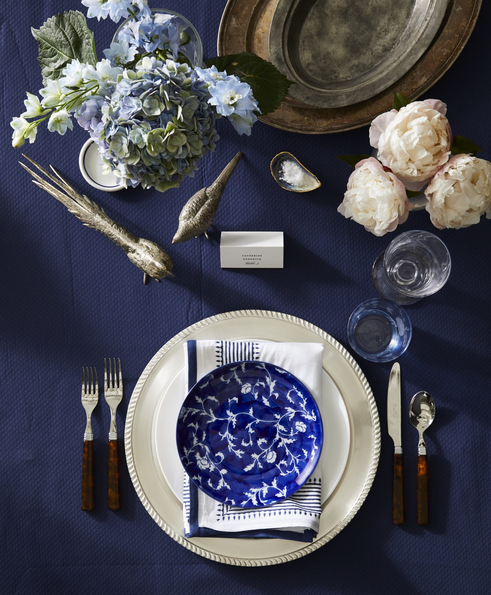 Classic Thanksgiving table with blue plate and silver accents