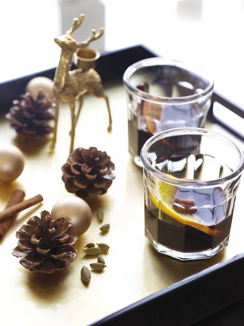 Thanksgiving table setting with deer candleholders and pinecones