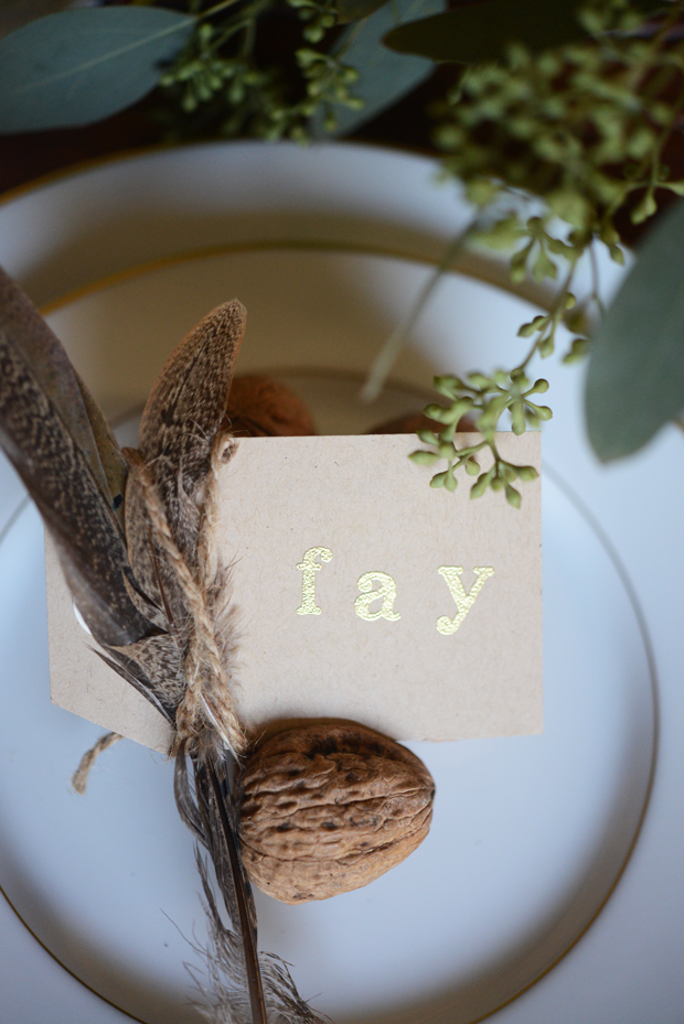 Thanksgiving place setting with name tag, feather