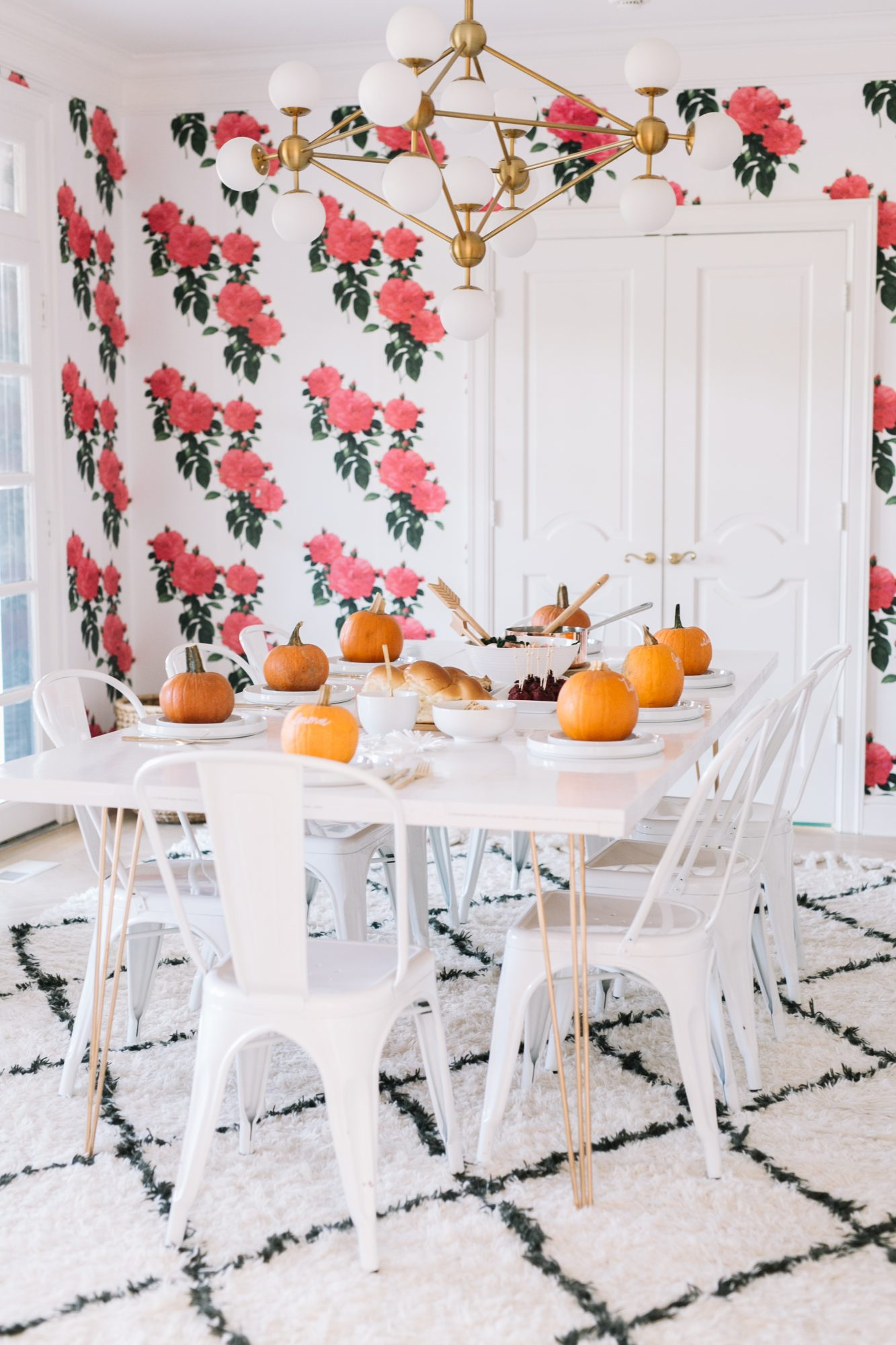 White Thanksgiving table with personalized pumpkins