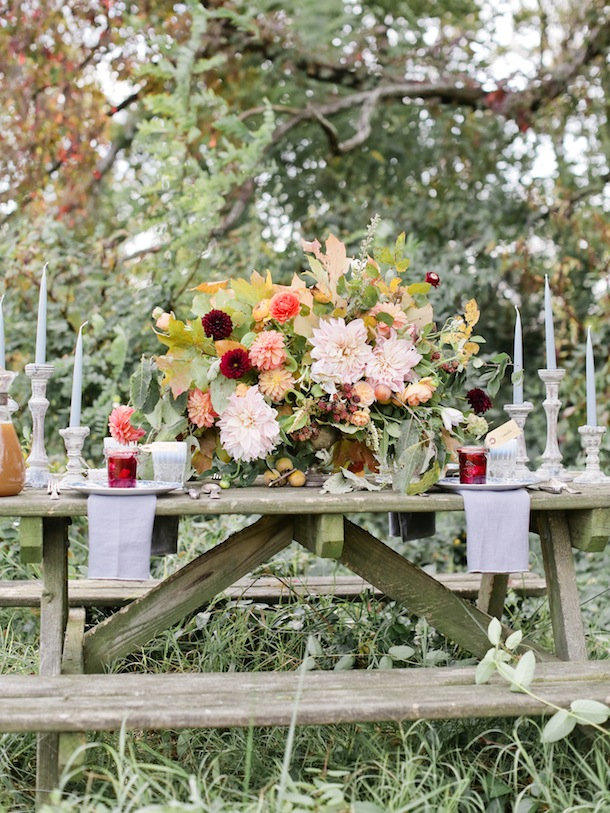 Outdoor Thanksgiving table with huge floral centerpiece