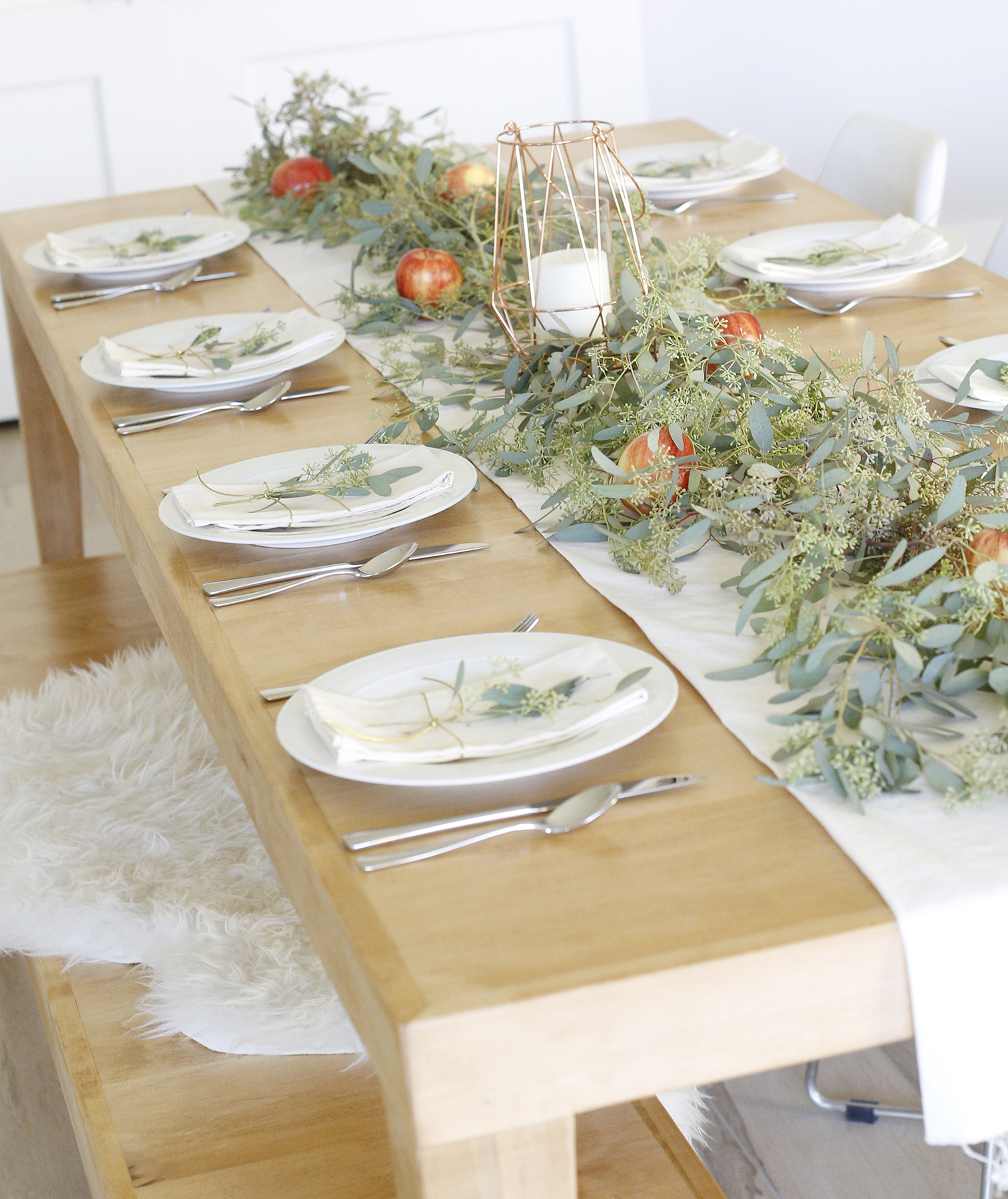 Thanksgiving table with fruit centerpiece and fur accents
