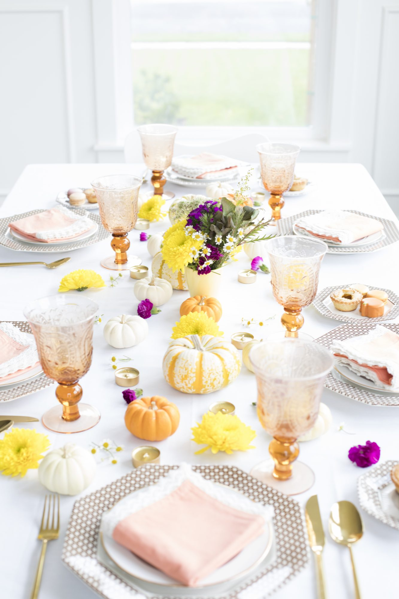 Thanksgiving table in white, pale oranges, yellows