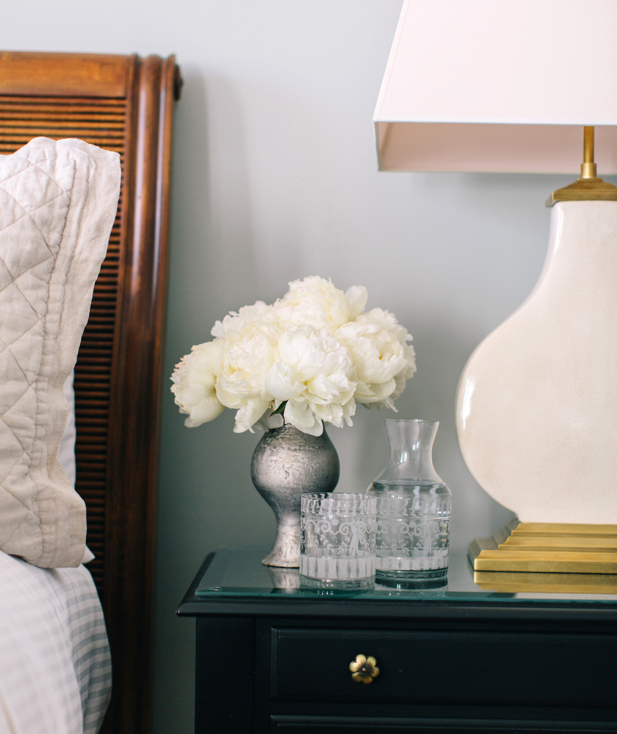 Nightstand with flowers, etched glass and decanter