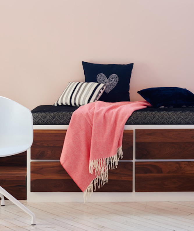 Storage bench with navy heart pillow, pink throw