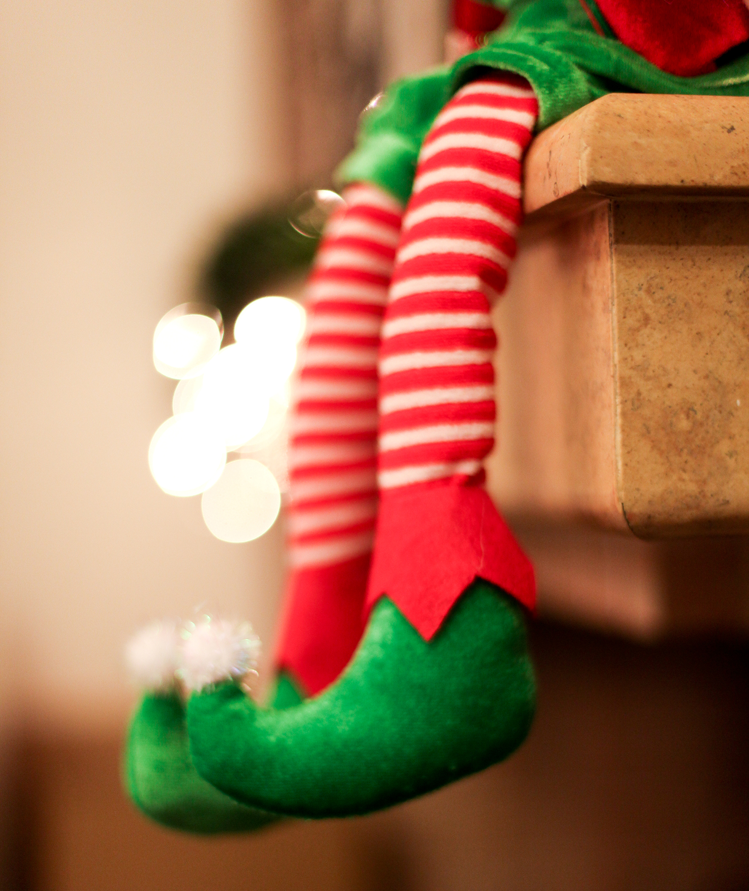 Christmas elf sitting on shelf