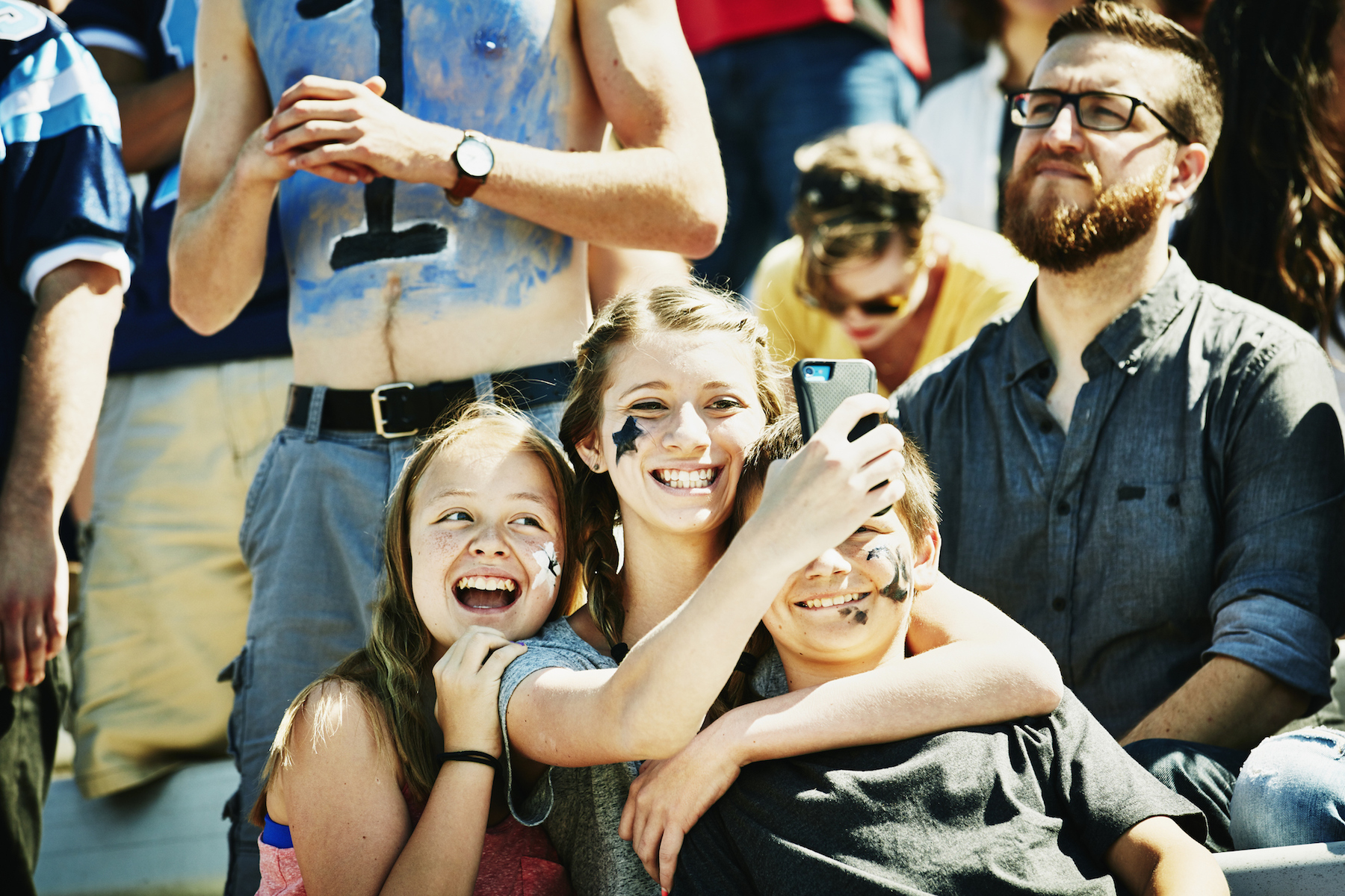 Family taking selfie at football game