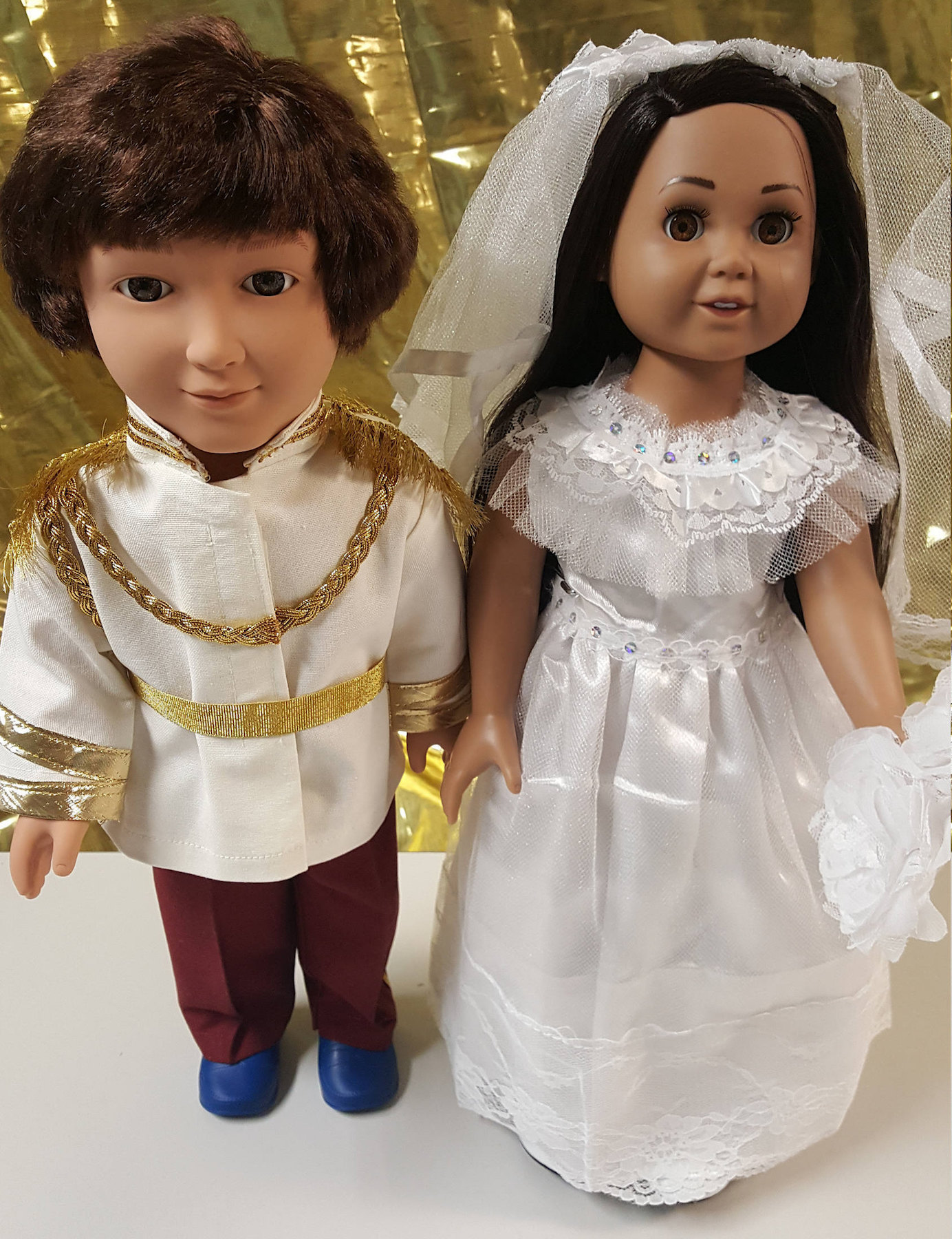 Meghan Markle and Prince Harry dolls in wedding attire