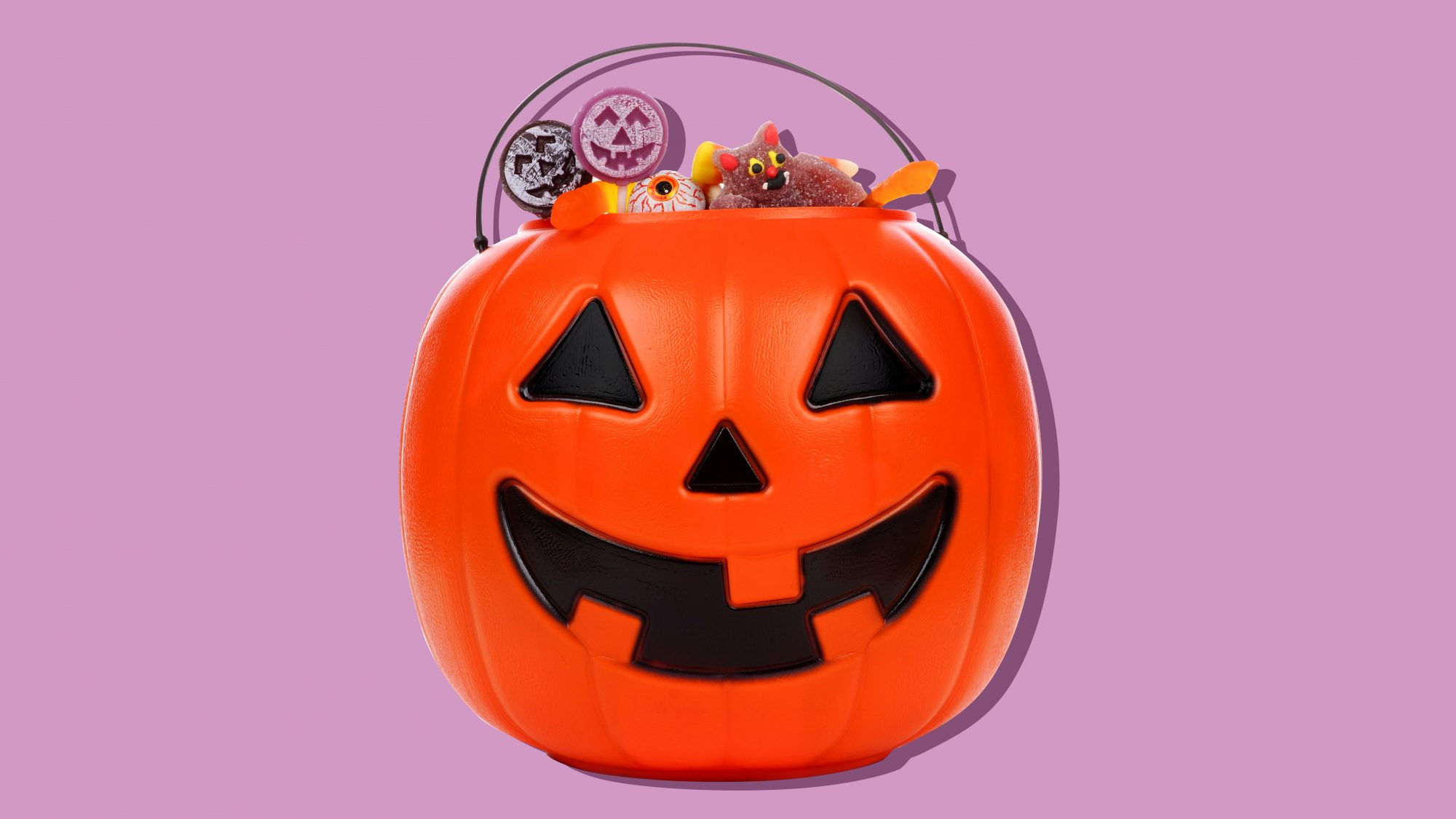 how old is too old to trick or treat? picture of jack-o'-lantern with candy