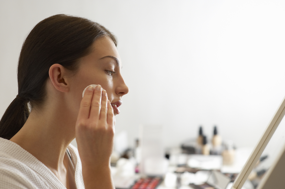 Woman Using Micellar Water to Cleanse Her Face