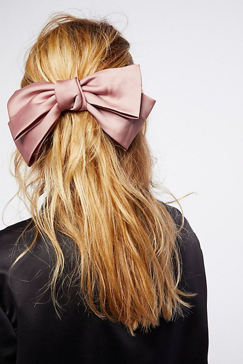 Pink hair bow on blonde model