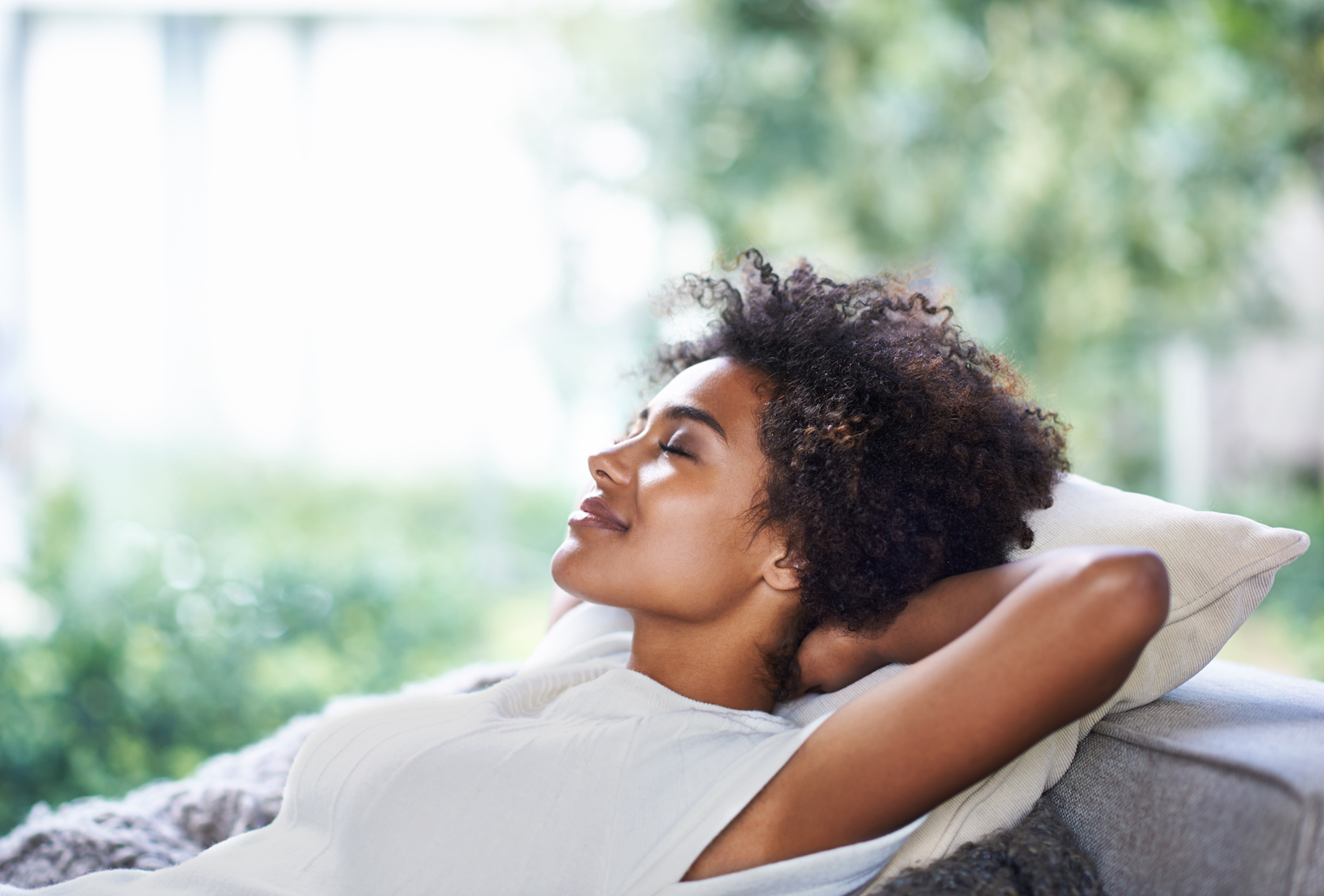 Woman relaxing with her eyes closed