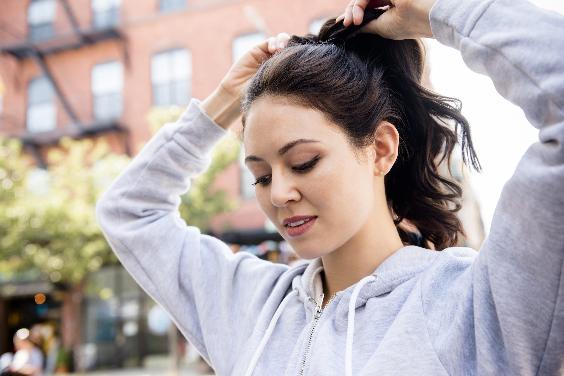Woman With Ponytail in sweatshirt outside