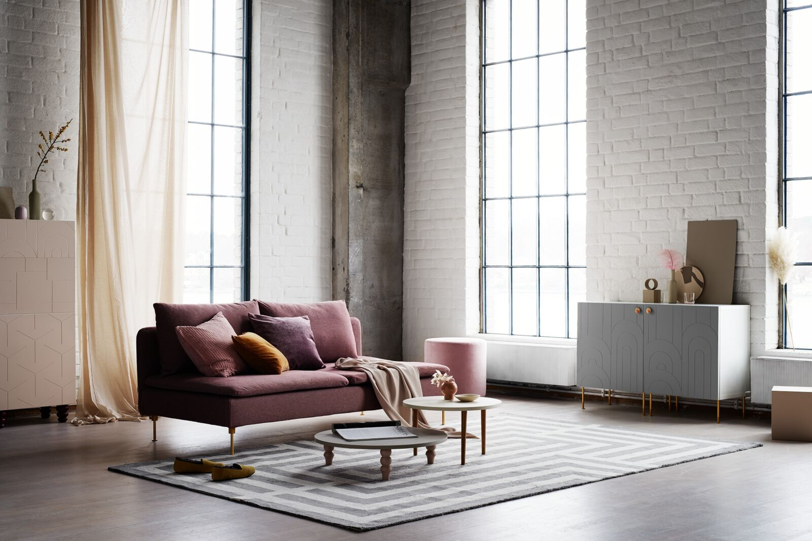 Prettypegs IKEA Living Room with pink couch, rug, and gray furniture