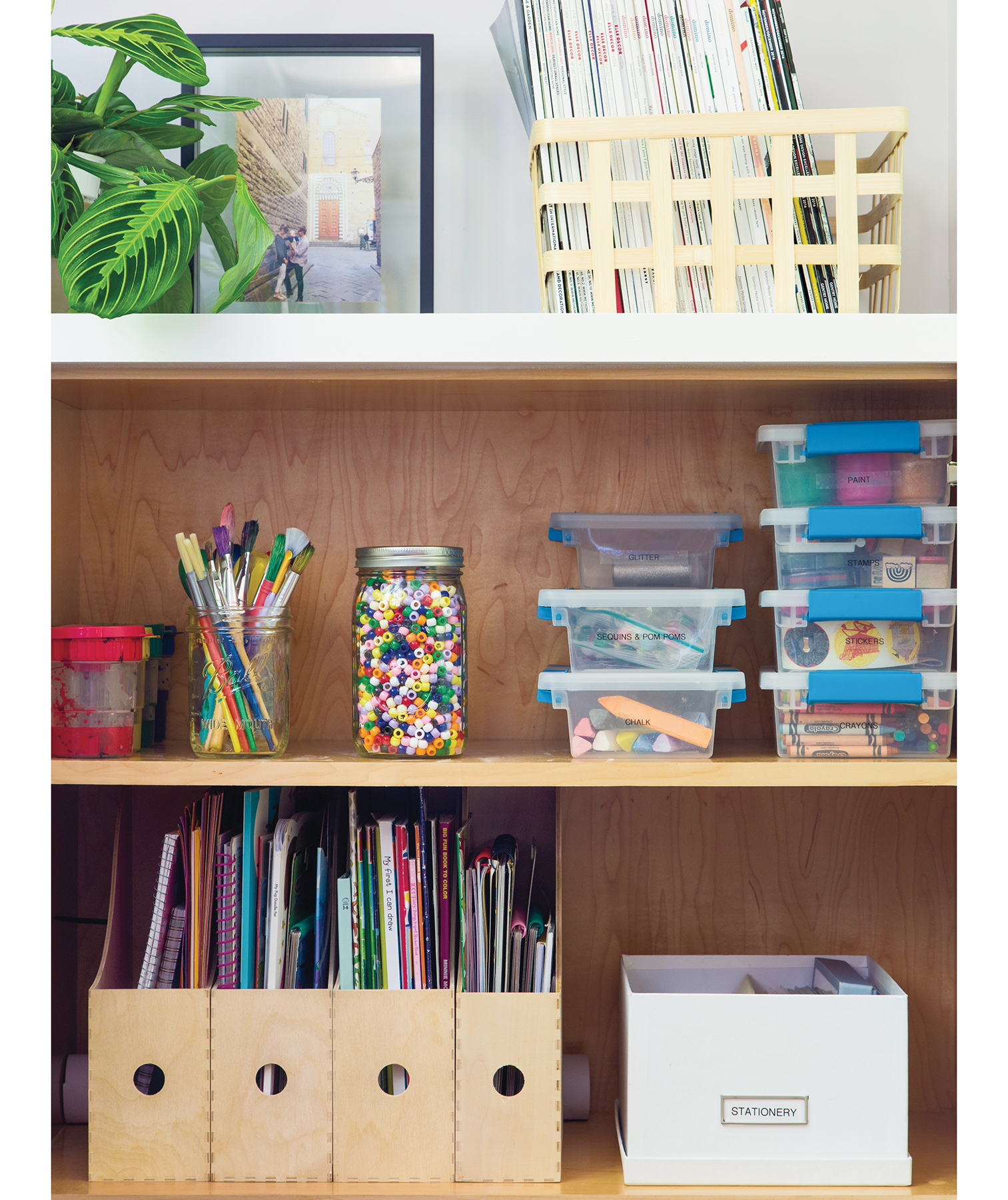 Cabinets full of kids' magazines, coloring books, notepads