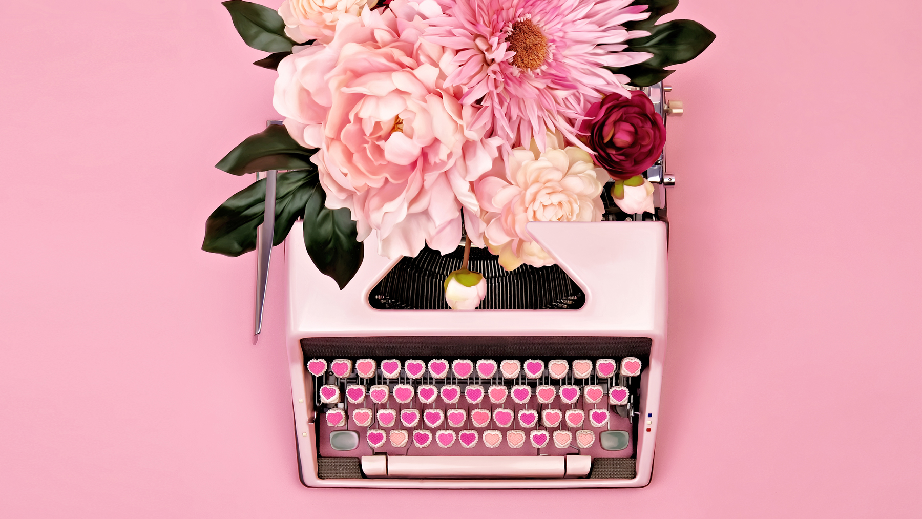 typewriter with Valentine's Day flowers