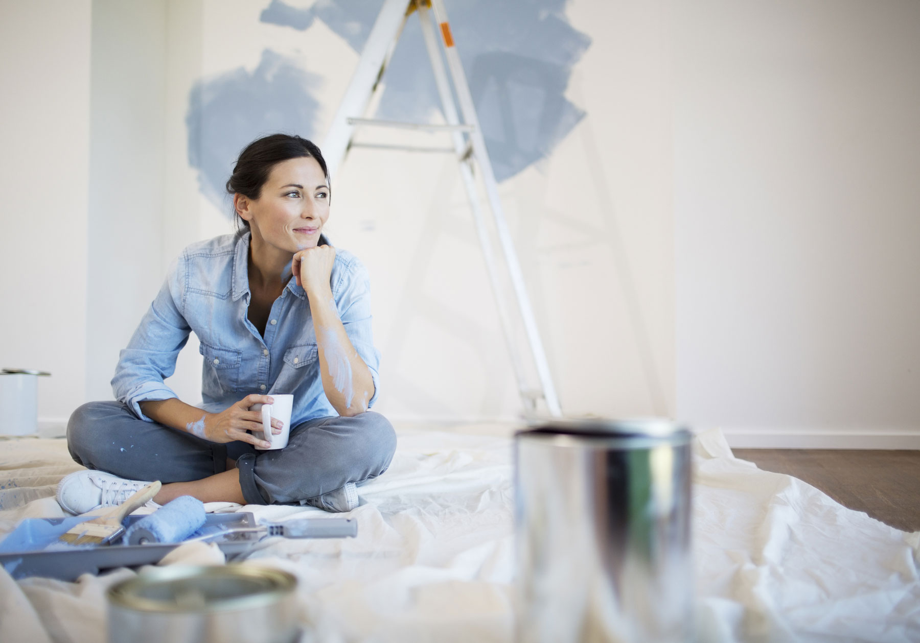 Woman painting her home