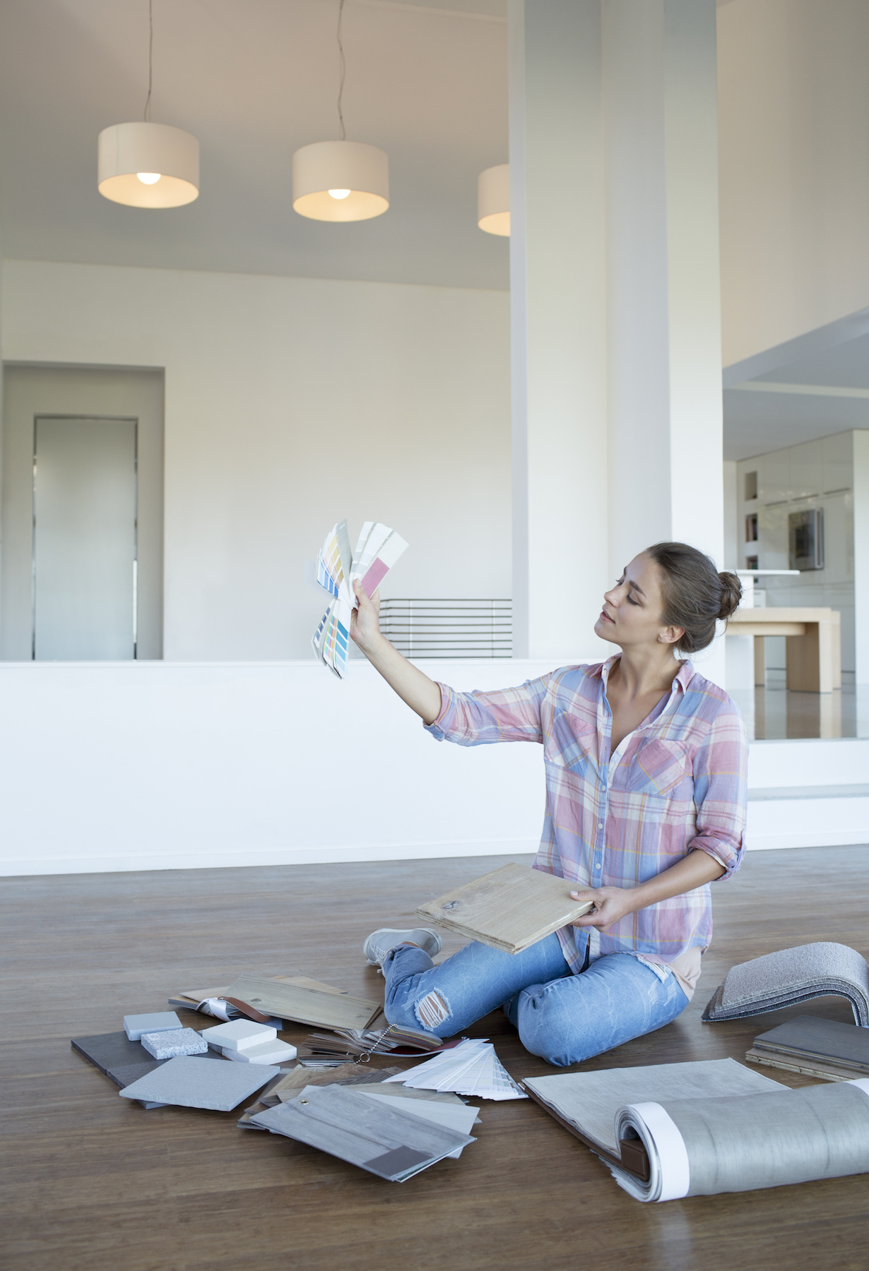 Woman Picking Paint Colors sitting on the floor