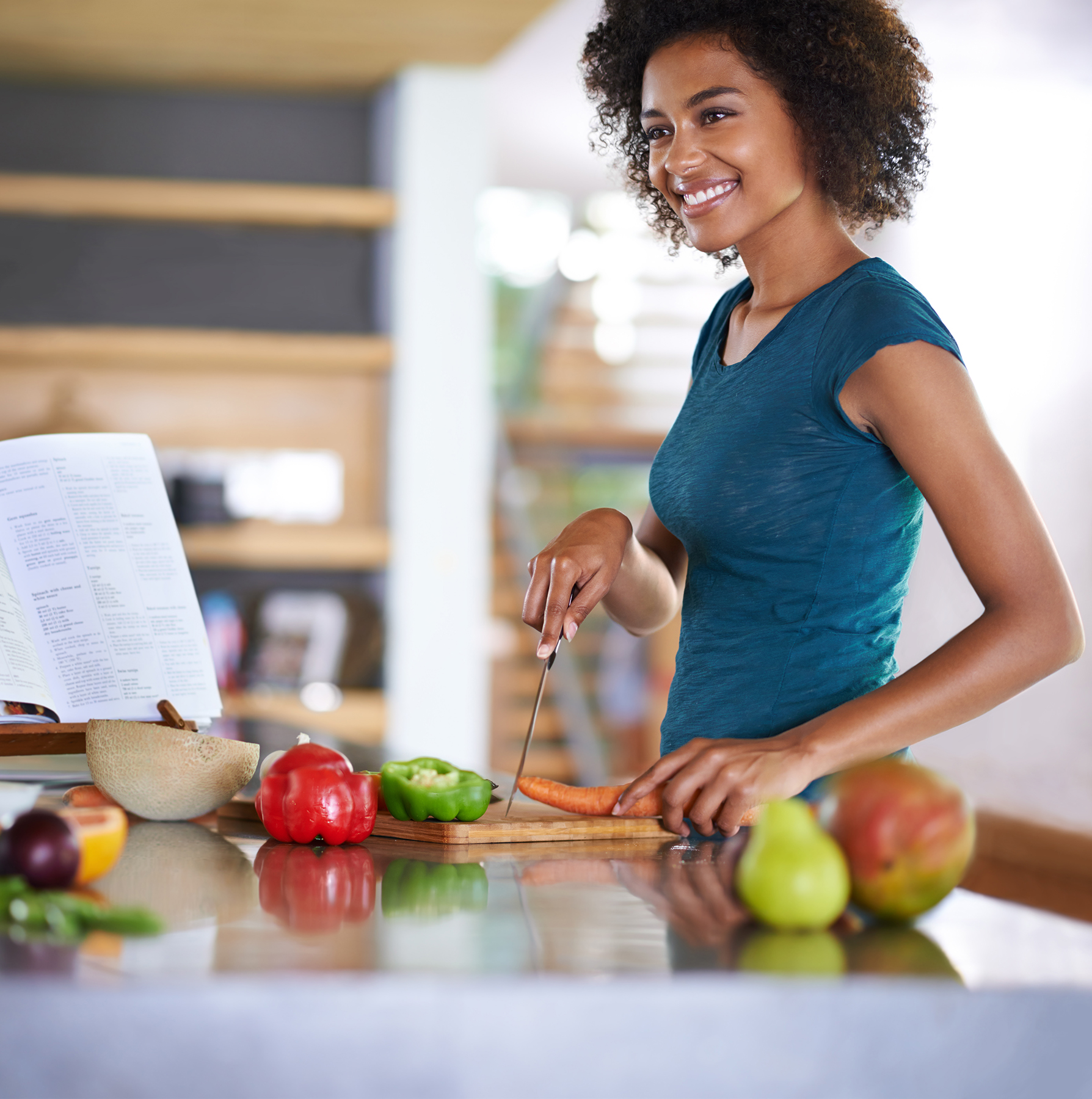 Woman preparing healthy food from cookbook