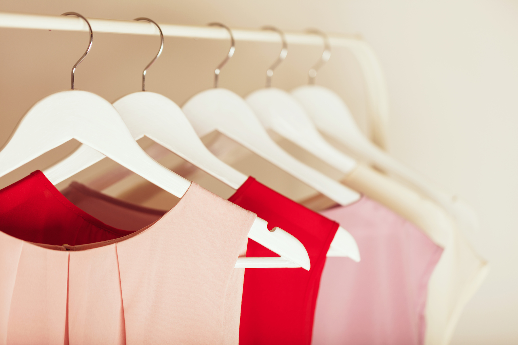 Organized Closet With Pink and Red shirts