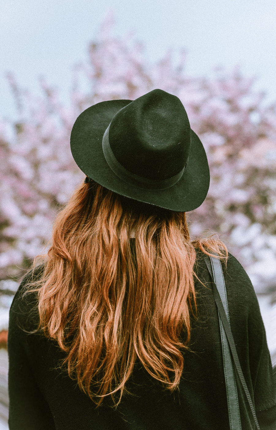 Woman Wearing Hat With Red Hair