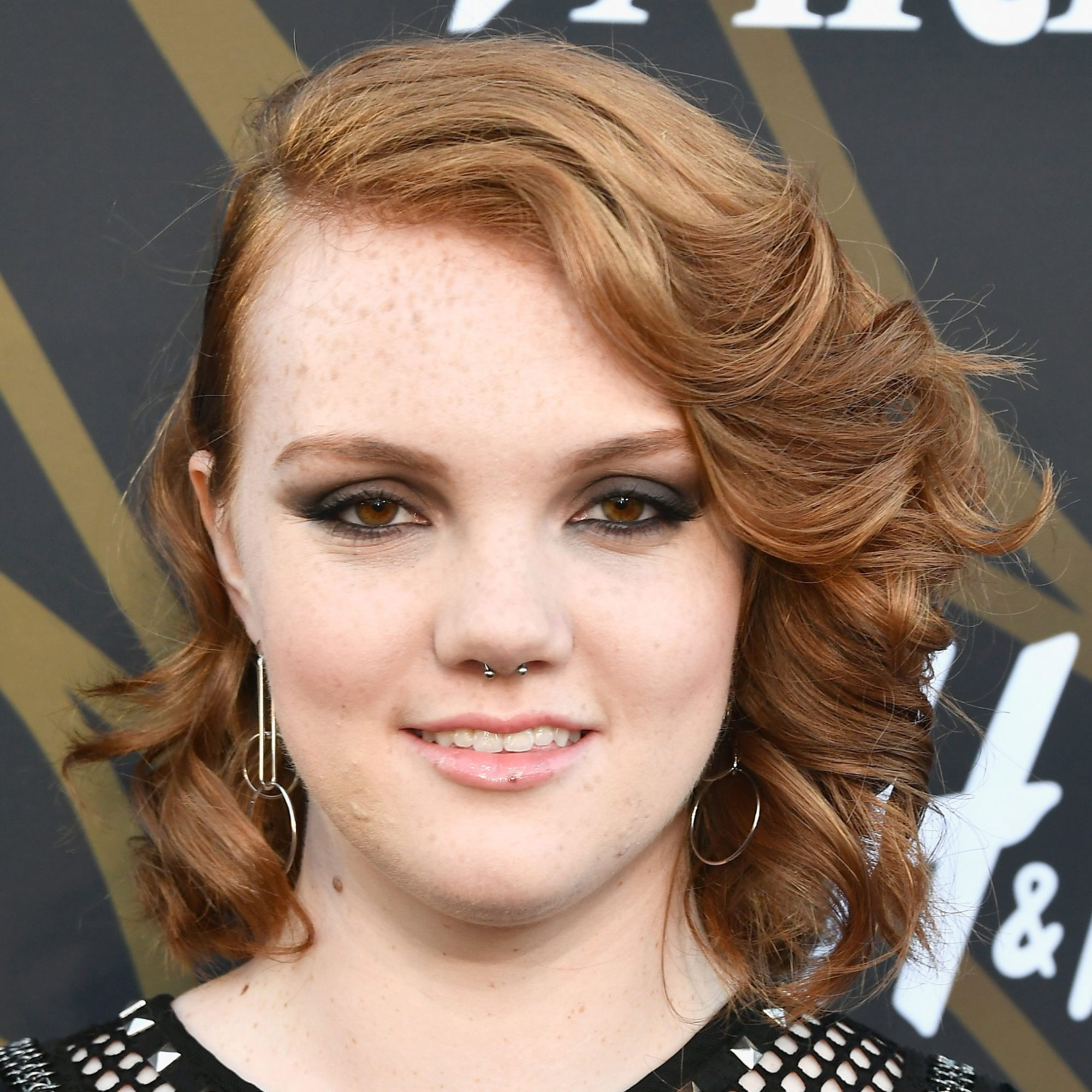 Medium Length Hairstyle: Deep Side Part and Vintage Curls, Shannon Purser