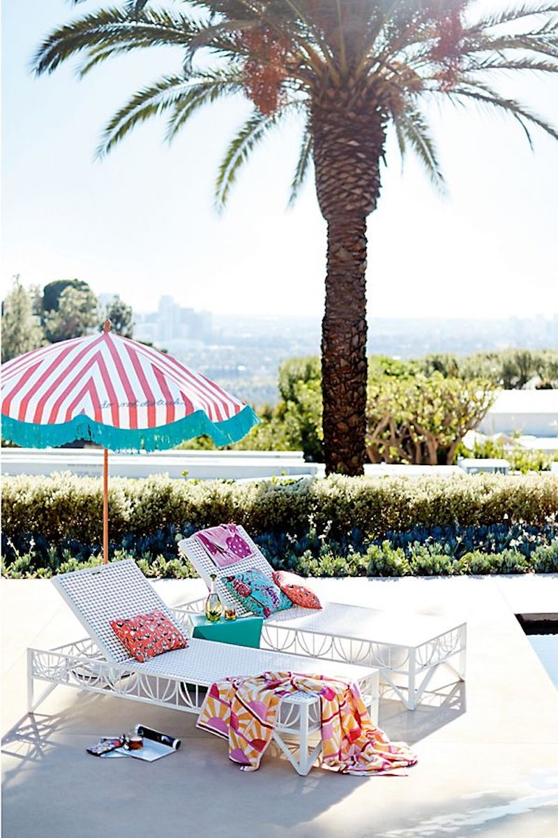 Anthropologie Outdoor Umbrella and beach lounge chairs