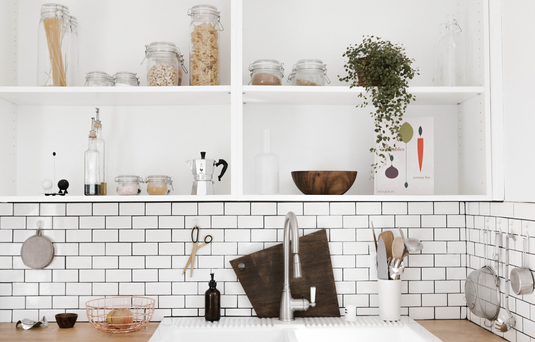 White kitchen sink with open shelving